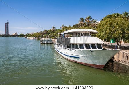 Yacht at a pier on Guadalquivir River in Seville Spain