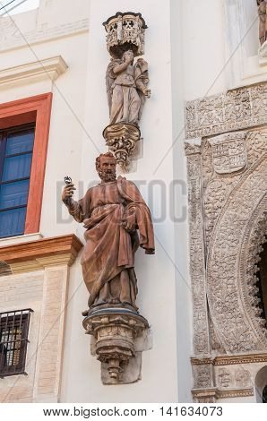 Statue of Saint Peter by the Gate of Pardon of Seville Cathedral Spain