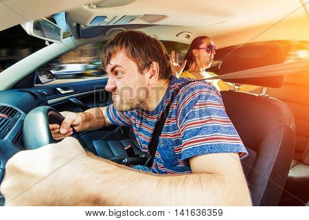 Angry man driving the car