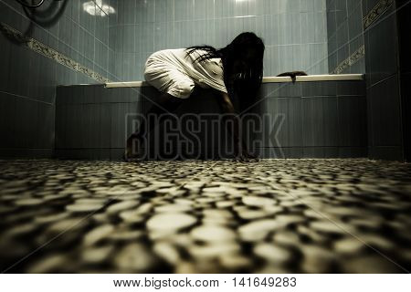 Scary person in white dress coming out from bathtub,Scary background for book cover