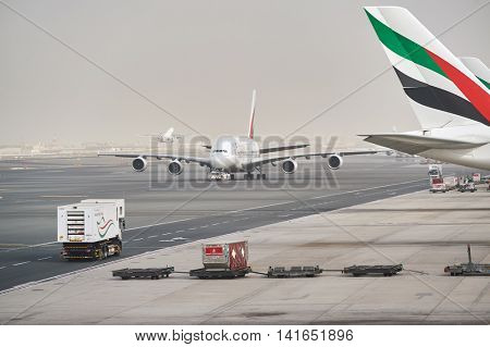 DUBAI - MARCH 10, 2015: Emirates Airbus A380 at Dubai International Airport. The Airbus A380 is a double-deck, wide-body, four-engine jet airliner manufactured by European Union manufacturer Airbus.