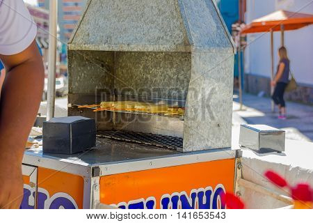 CURITIBA , BRAZIL - MAY 12, 2016: some cheese sticks grilled in a small food car located in the market place.