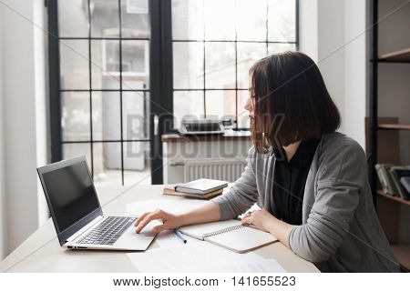 Bored office worker at desk staring at computer screen. Boring uninteresting work, tiredness concept
