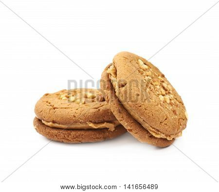 Two peanut butter homemade cookies isolated over the white background