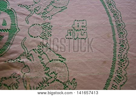 pink and green checked tablecloth background, top view