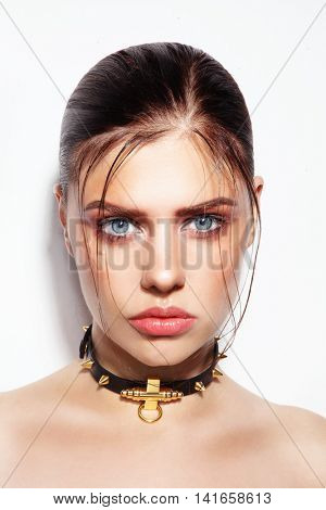 Portrait of young beautiful sexy woman with wet glossy skin and hair
