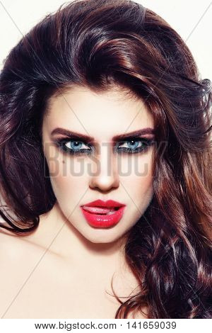 Portrait of young beautiful sexy teasing woman with stylish make-up and hairdo poster