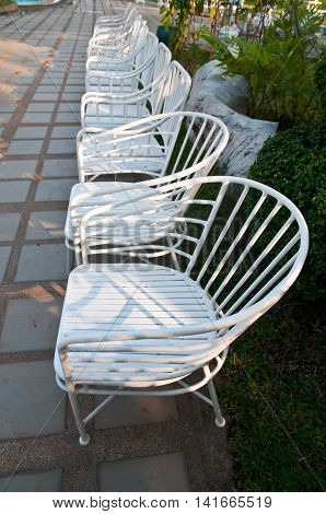 white chairs in a garden, outdoor chair