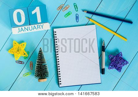 January 1st. Day 1 of month, calendar on teacher workplace background. Winter time. Empty space for text.