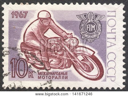 MOSCOW RUSSIA - CIRCA APRIL 2016: a post stamp printed in the USSR dedicated to the Motor Cycling Competition in Moscow circa 1967