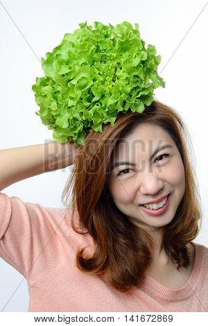 asian woman hold hydroponics green oak vegetable on her head