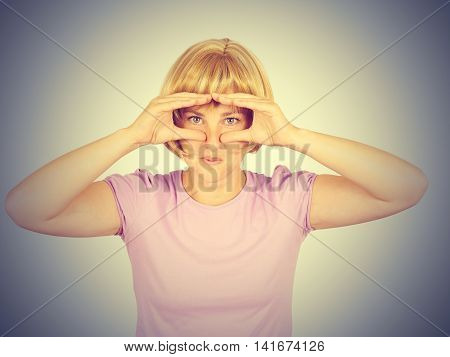 Angry Upset Young Woman Curious Looking Through Fingers Like Binoculars