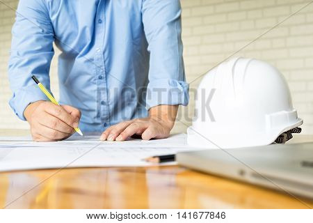 architect drawing architectural project on blueprint engineering concept architecture concept soft focus vintage tone
