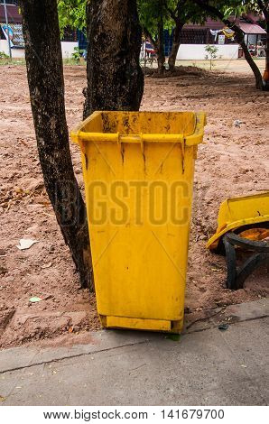 yellow garbage bins in the park, public garbage bins