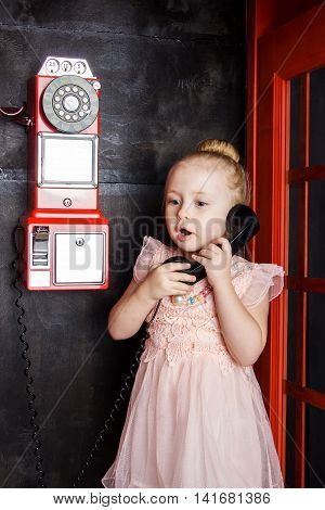 Little girl with handset in hand closeup