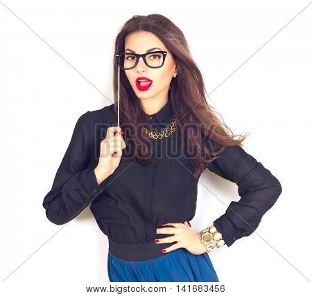 Beauty sexy fashion model girl wearing funny paper glasses on stick, isolated on white background. Beautiful young brunette woman with trendy accessories posing in studio