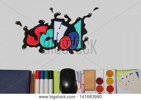 school text word painted graffiti with smiley eyes on paper near pencils markers computer mouse chalk ruler paint palette wooden cube notebook and alphabet on white background poster