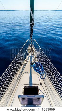 Front View Of Sailing Boat On The Sea.