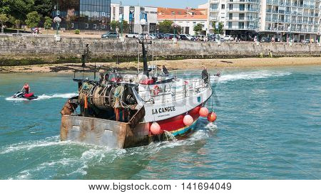 les Sables d Olonne France - July 24 2016 : a fishing boat returns to port