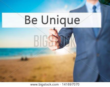 Be Unique - Business Man Showing Sign