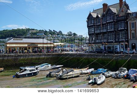DARTMOUTH, UK - JULY 6: Crowds throng the South Embankment harbour promenade in the coastal riverside town of Dartmouth, Devon on July 6, 2016.