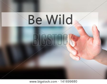 Be Wild - Hand Pressing A Button On Blurred Background Concept On Visual Screen.