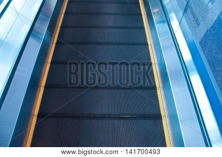 Moving escalator in an airport, background escalator