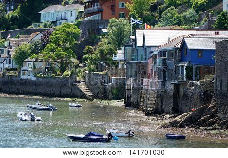 DARTMOUTH, UK - JULY 6: Ladders exposed by the low tide lead down to the rocky shore of the estuary of the River Dart in the Devon town of Dartmouth, England on July 6, 2016.