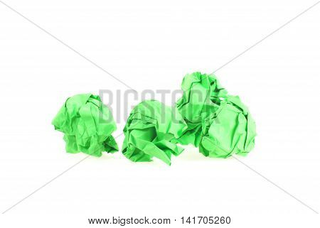 Four isolated light green Paper Balls with copy space