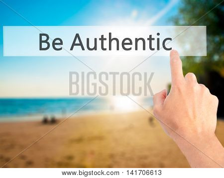 Be Authentic - Hand Pressing A Button On Blurred Background Concept On Visual Screen.