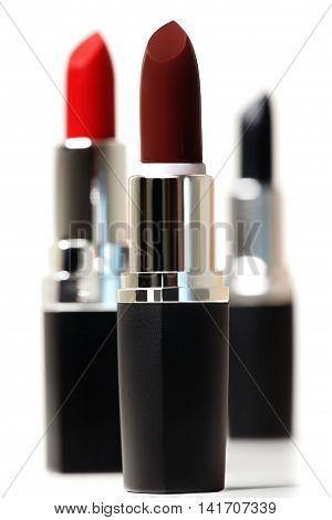 Set of color lipsticks. Red lipstick black lipstick wine lipstick isolated on white background