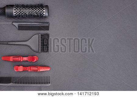 Salon Hairdresser Accessories, pink Comb, application brush, brashing for cutting hair or colored on a black background