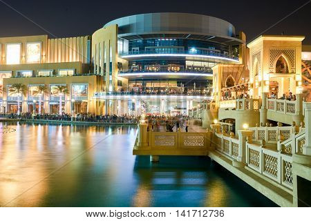 DUBAI, UAE - OCTOBER 15, 2014: outside Dubai Mall near the Fountain. The Dubai Mall is a shopping mall in Dubai and the largest mall in the world by total area.
