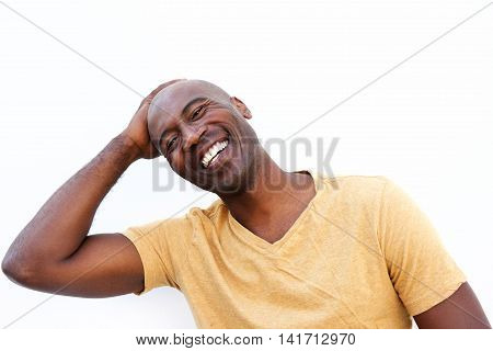 Smiling Young African Man Against White Background
