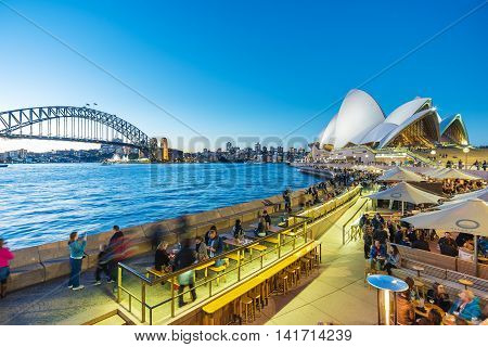 Sydney, Australia - June 25, 2016: People dining at outdoor restaurants in Circular Quay in Sydney, Australia