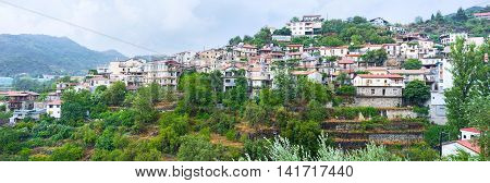 The picturesque Agros village on the of the Troodos surrounded by green terraced gardens Cyprus.
