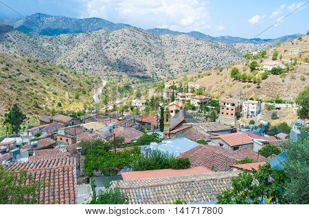 The tiled roofs of the old mountain village with the Troodos mountains on the background Gourri Cyprus.