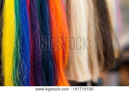 vigorously colorful strands of hair to choose from - Closeup