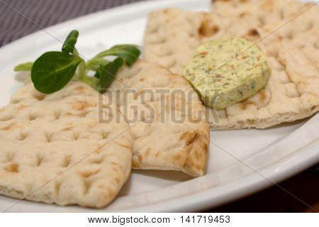 fresh and singular pita bread with herb butter