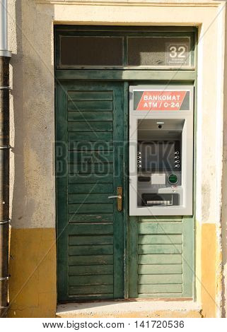 Atm in old green grunge door. Bancomat machine in Croatia.