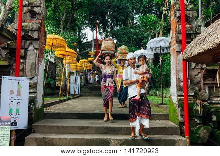 Balinese Family In Traditional Clothes