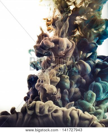 Ink in water. Abstract background. . Ink swirling in water. Ink in water isolated on white background. Colorful ink in water.