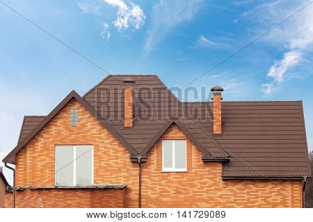 New brick house with modular chimney Stone Coated Metal Roof Tile plastic windows and rain gutter