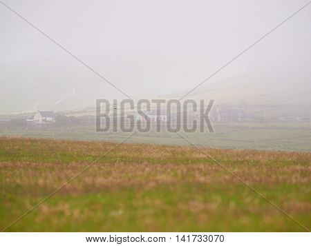 Houses in Dingle Ireland on a foggy and misty day