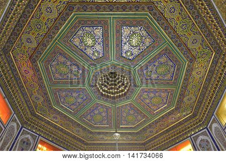 Bukhara, Uzbekistan - August 05 2015: the Old Eastern ornament. Vintage oriental patterns decorate the ceiling in Bukhara.