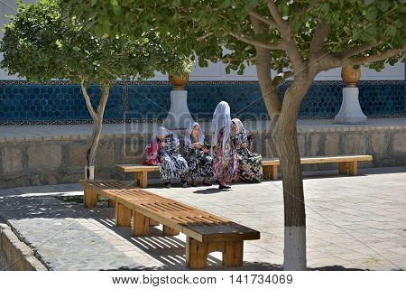 Bukhara Uzbekistan - 05 August 2015: pilgrims rest on the Central square of the memorial complex of BAHAUDDIN Naqshbandi in Bukhara.