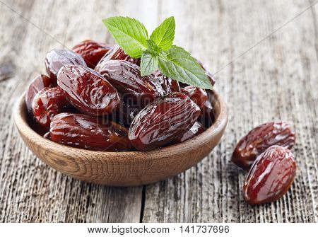 Dates fruit with mint leaves