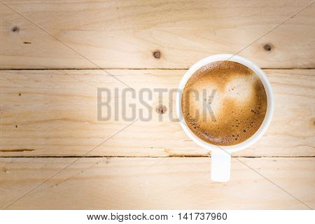 Coffee Cup Taken In Top View On Wooden Table