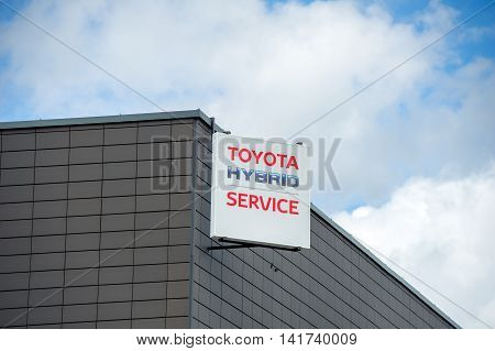 VILNIUS, LITHUANIA - AUGUST 7, 2016: Toyota Hybrid Service logo. Toyota Motor Corporation is a Japanese automotive manufacturer. Hybrid Synergy Drive (HSD) is the brand name of Toyota.
