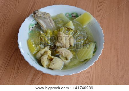 pickled Chinese cabbage with pork entrails and bone soup in bowl